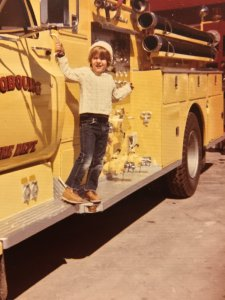 Sean as a child on Cobourg Ontario fire engine